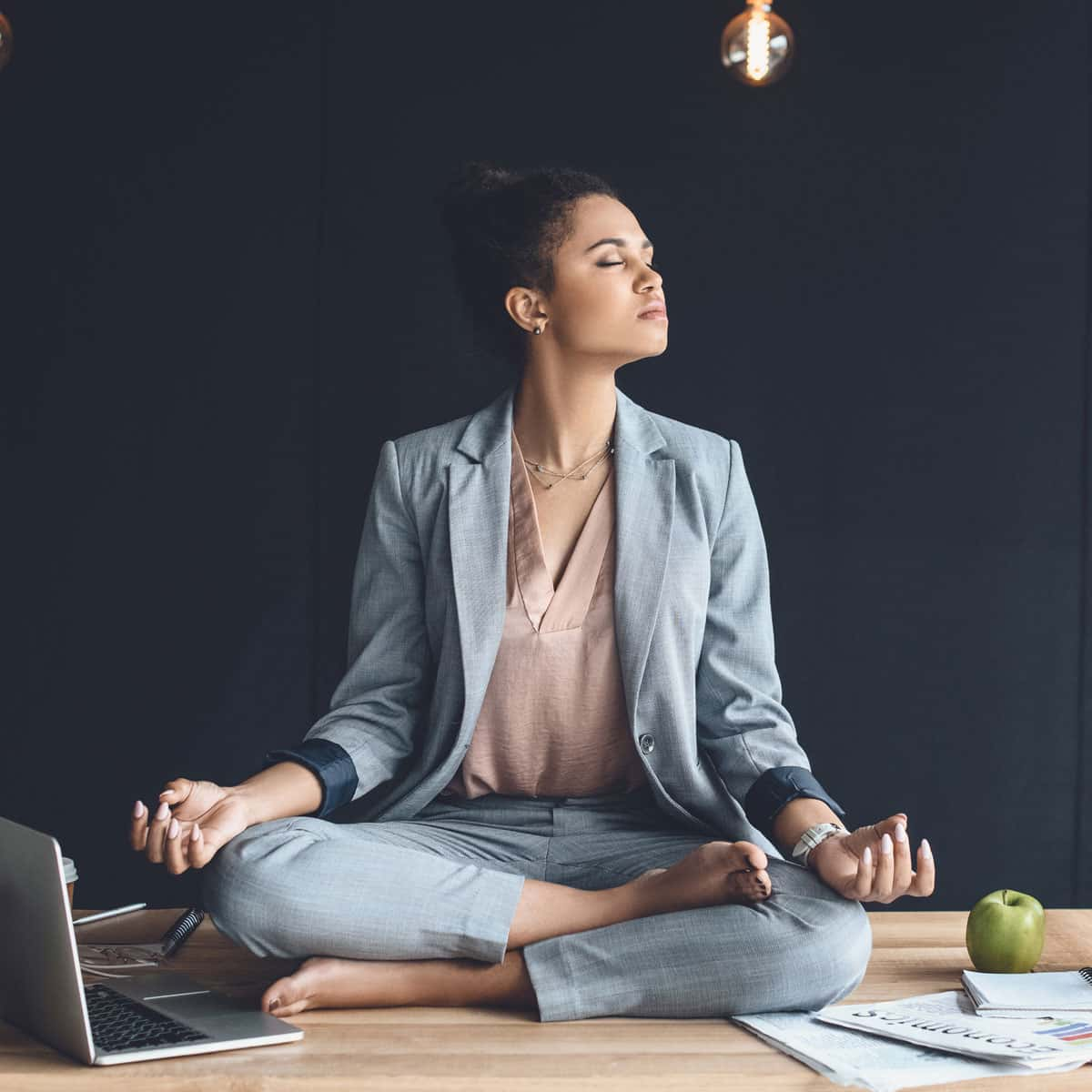 Woman meditating to relax at work