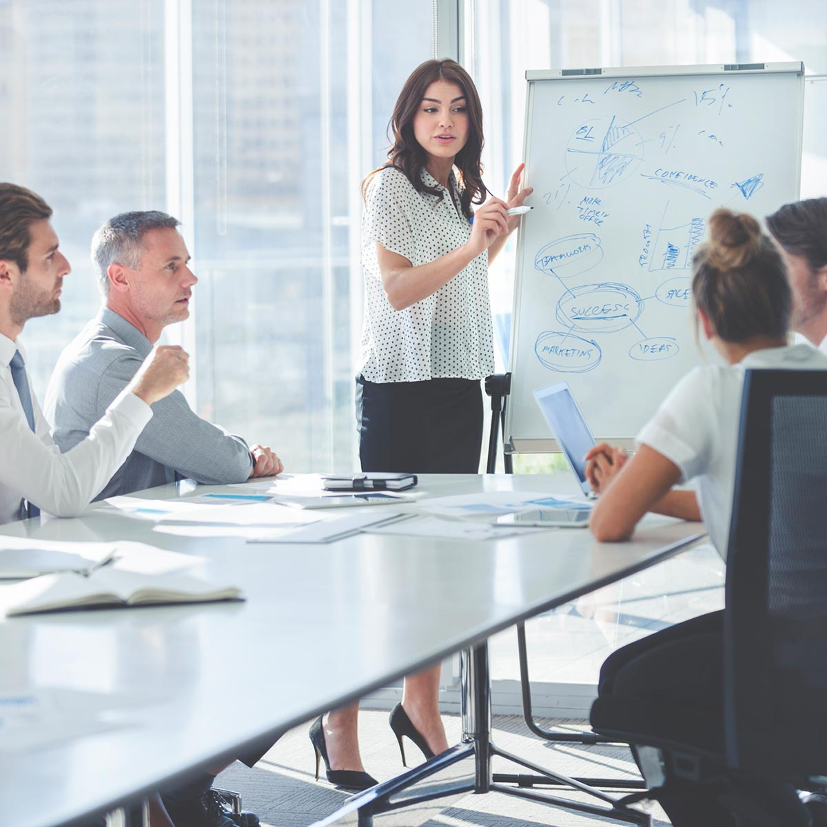 woman on a meeting with team