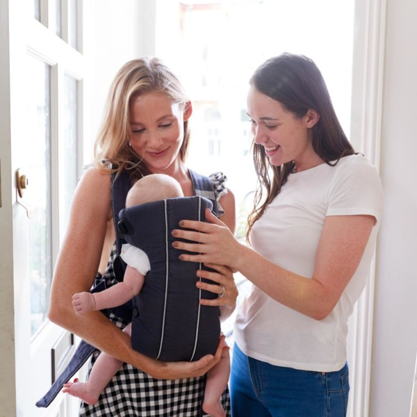woman congratulating another woman about her new baby