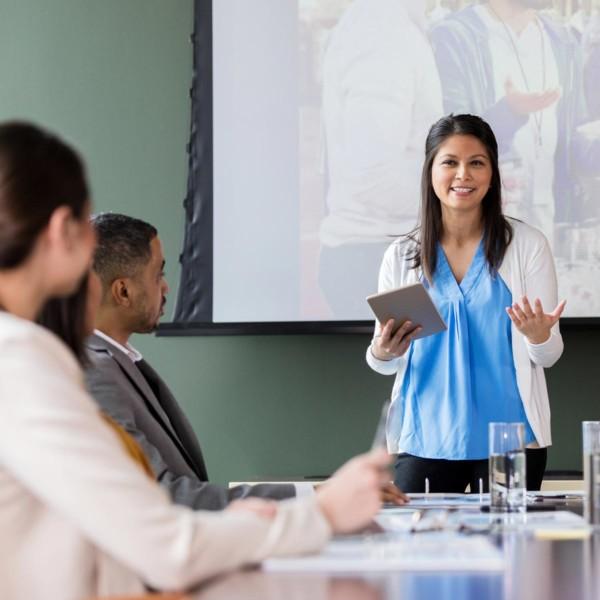women discussing volunteering with her peers at work