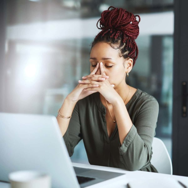 women stressed working on her computer