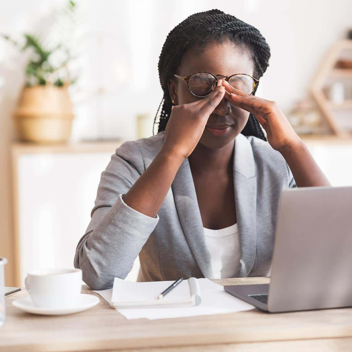 women stressed at her desk