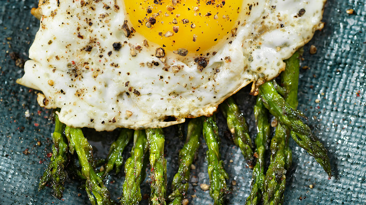 Image of Truffle Asparagus with Fried Egg Plated