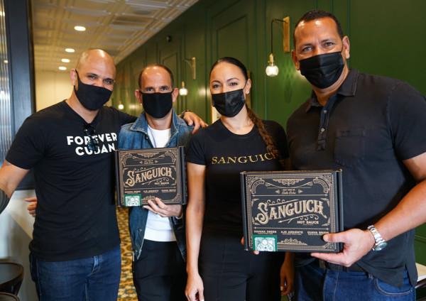 Marcus Lemonis with Sanguich crew