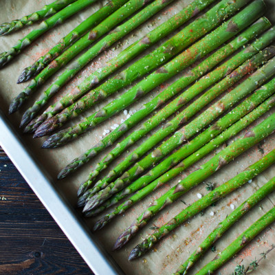 Image of asparagus laid out on a sheet pan