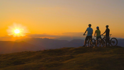 Three bikers overlooking the sunset to maintain their friendship