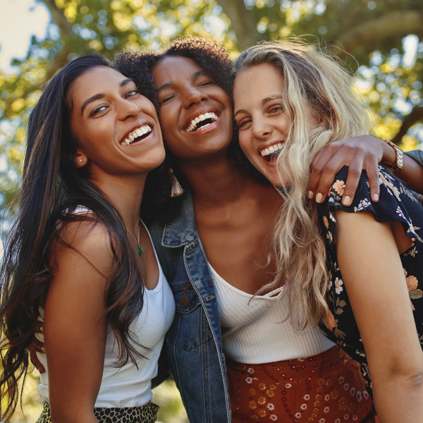 Group of 3 girls laughing and having fun to maintain their friendship