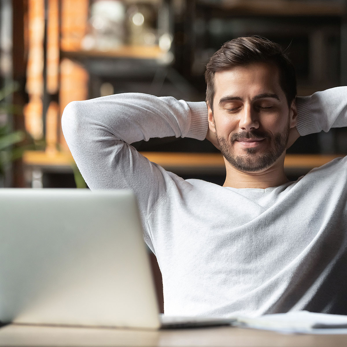 image of man relaxing and recognizing his progress towards success