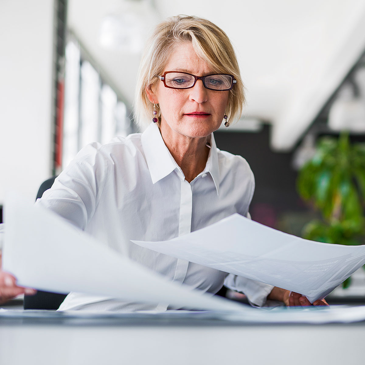 image of woman sifting through papers on desk