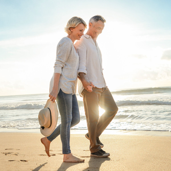 Image of an older couple on date at the beach.
