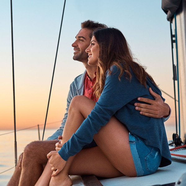 Image of a couple on a date on a boat.