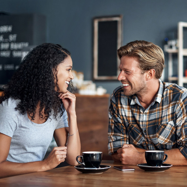 couple enjoying first date in coffee shop