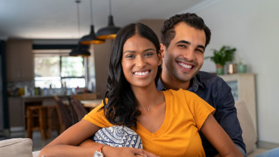 Image of a couple sitting on the couch.