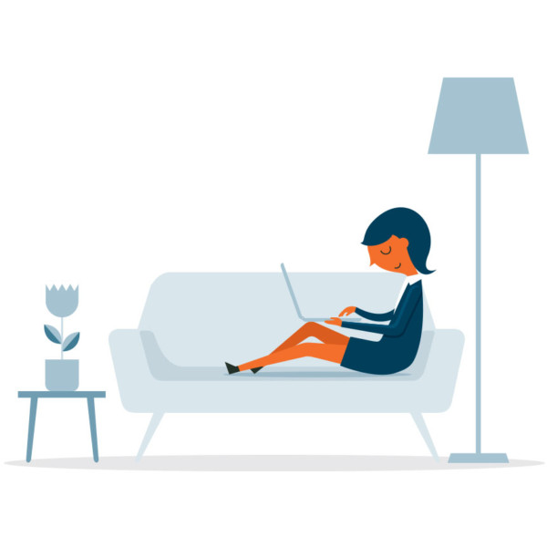 Image of someone working on their laptop on the couch