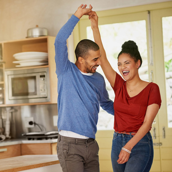 Image of a couple dancing together in the kitchen.