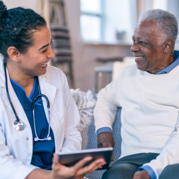 Doctor looking at charts with patient smiling
