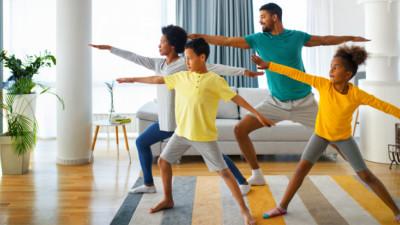 Family doing yoga in their living room