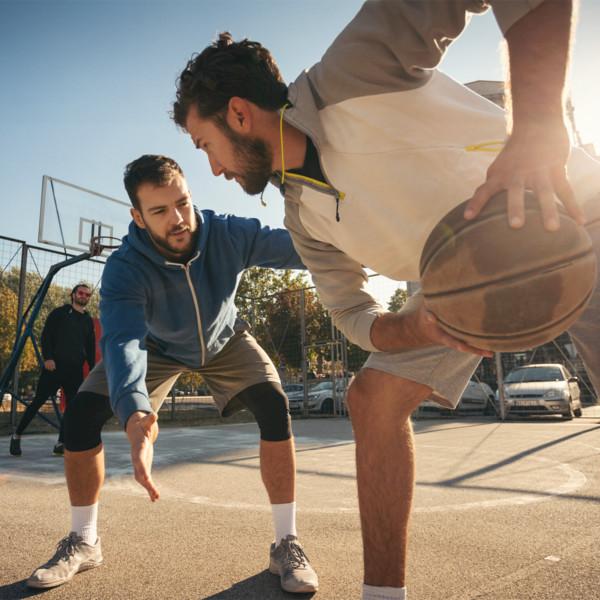 Friends playing basketball outside