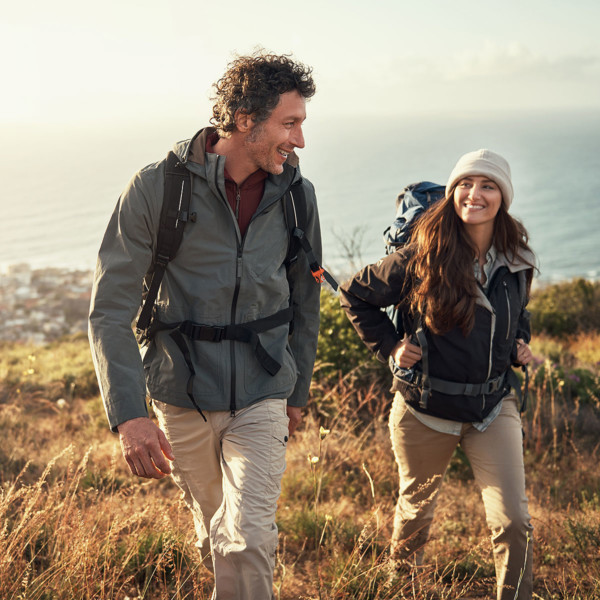 Image of two people on a date taking a hike.