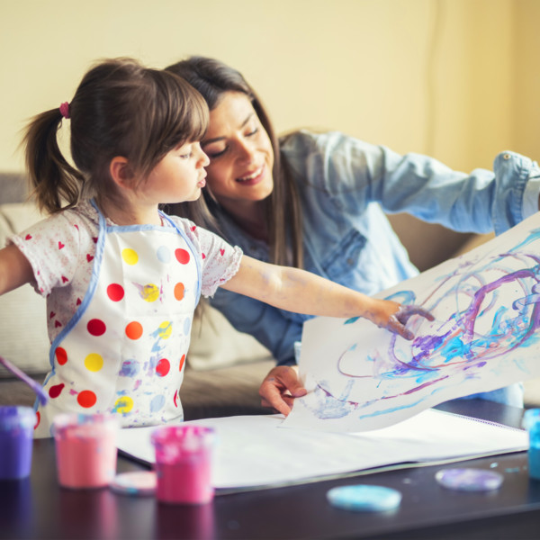 Image of a mother and daughter painting together.