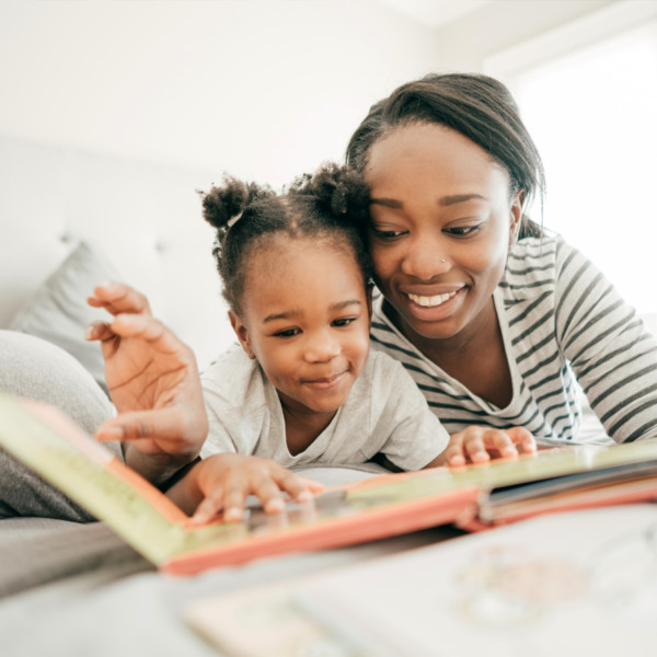 Image of a mother and daughter reading together.