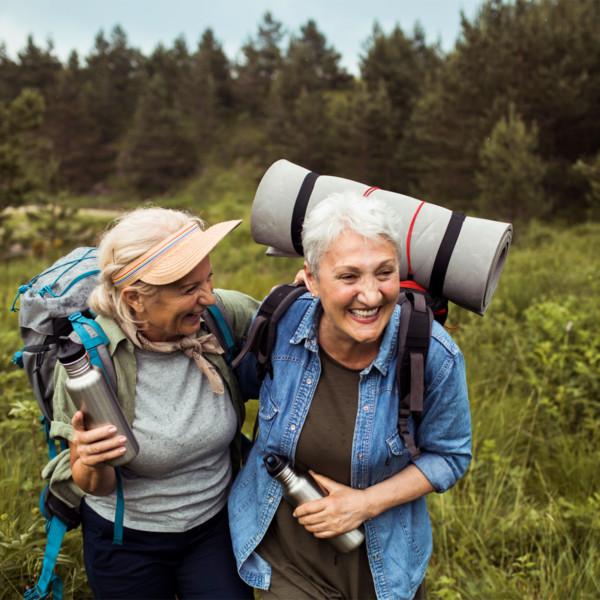 Older woman hiking through nature
