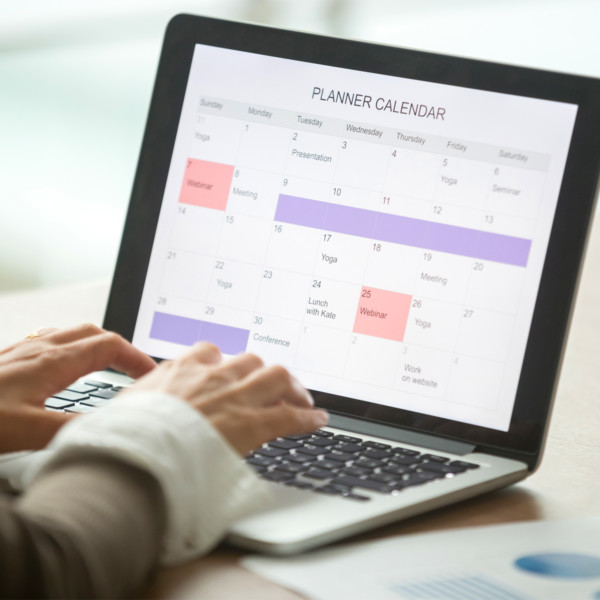 woman scheduling time to manage debt with planner