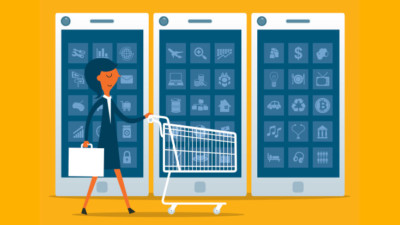 Image of someone pushing a shopping cart in front large phones.