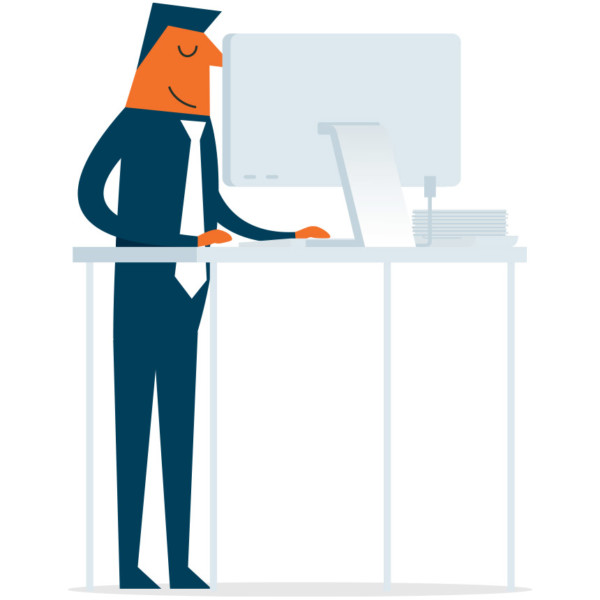Image of someone working on a standing desk.