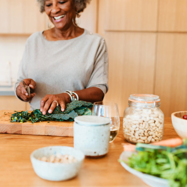 Woman chopping kale for salad