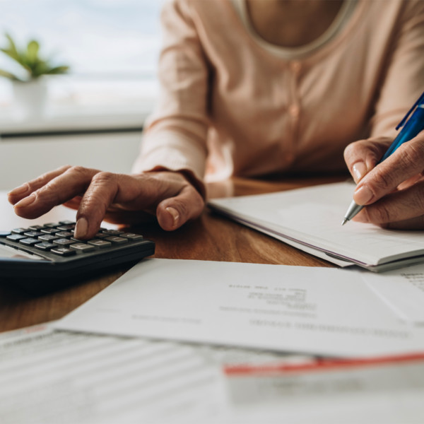woman making calculations to help manage debt