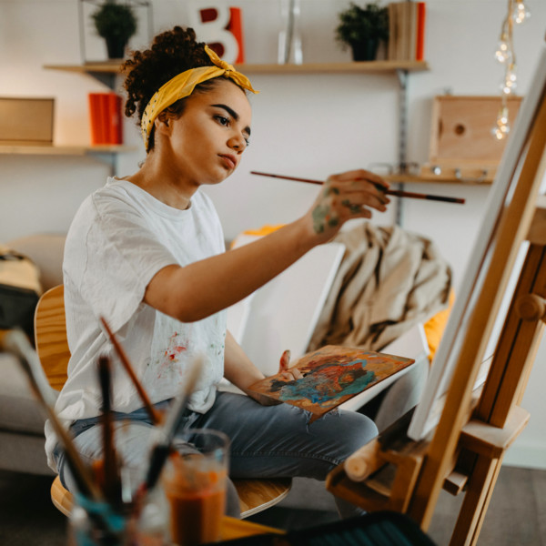 Woman finding her passion through painting in her studio