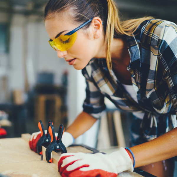 Woman working with wood in workshop