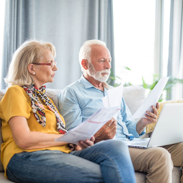 couple reviewing papers in hopes of understanding taxes