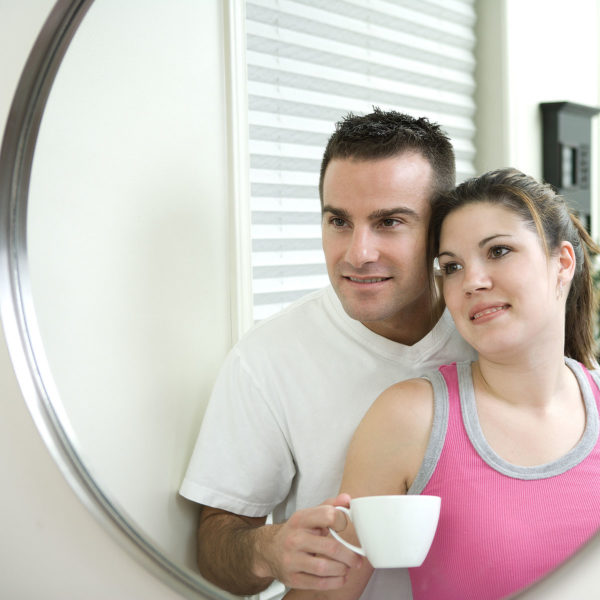 Image of a couple together looking into a mirror