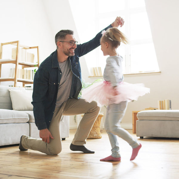 Image of a dad playing with his daughter