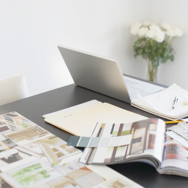 Image of home design books on table with computer