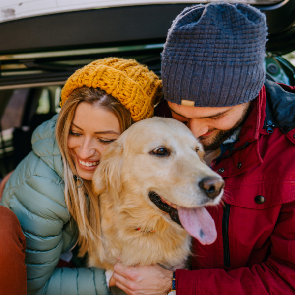 couple with dog enjoying their relationship