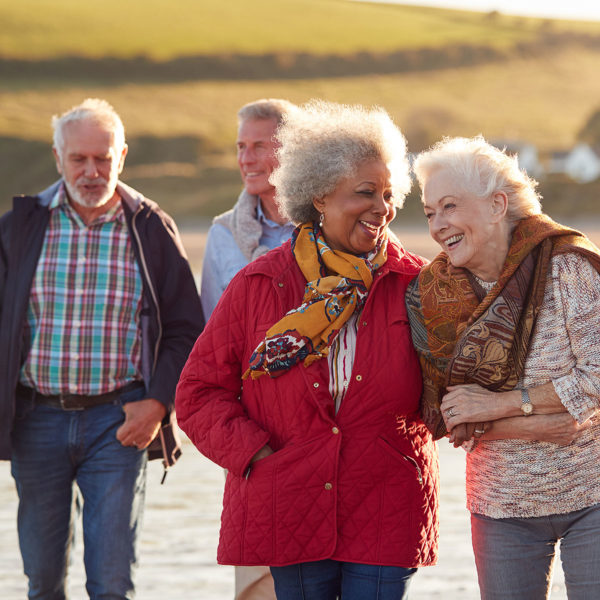 Image of a group of elderly friends together outside