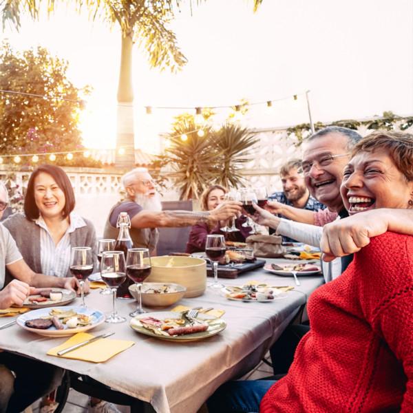 Image of family eating dinner at sunset outside