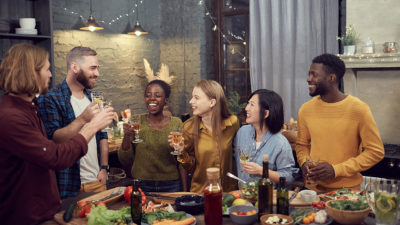 Image of a group of friends sharing drinks together