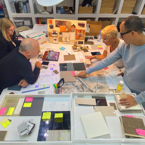 Marcus & Bobbi Lemonis working with team to on mood board to design home