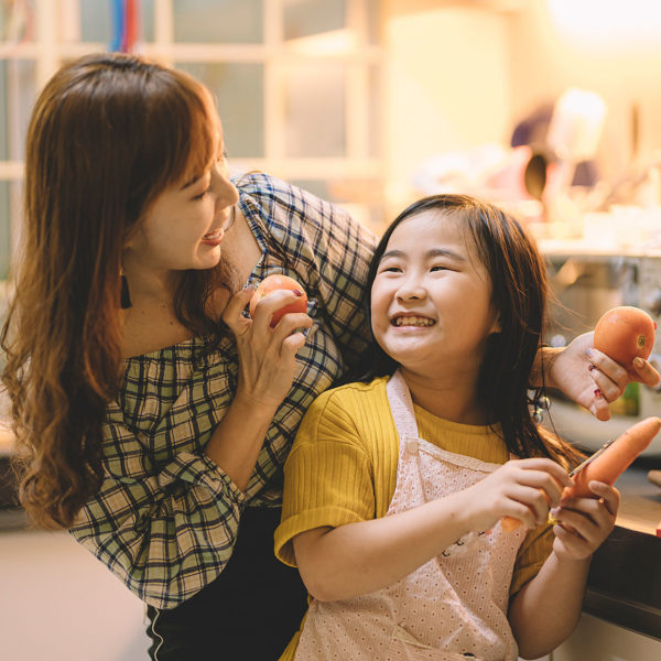 Image of a mother and daughter cooking together