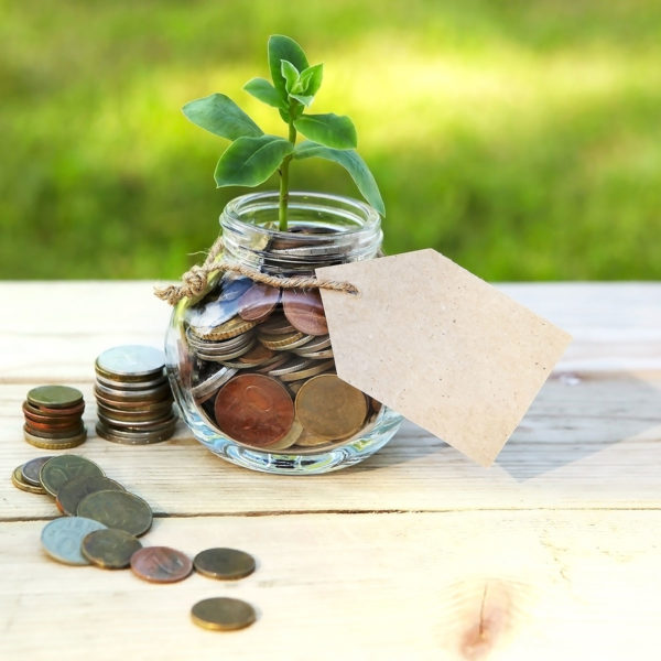 Image of coins in jar to symbolize savings