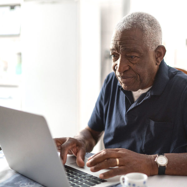 Image of someone on a laptop