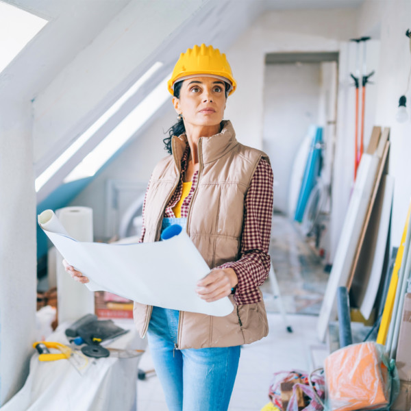 Image of woman wearing hard hat during home construction