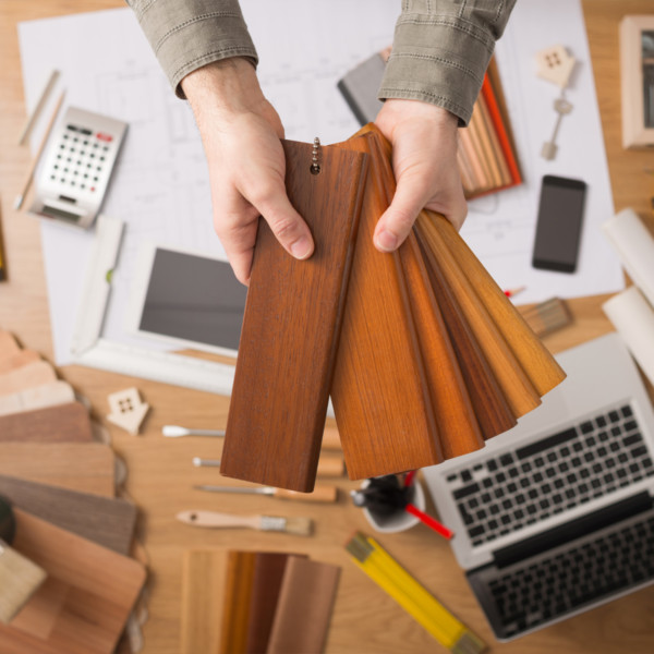 Image of hands holding wood trim selections