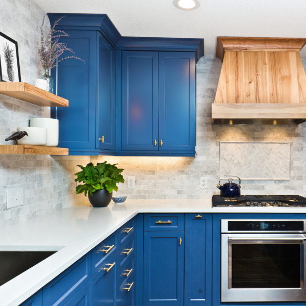 Image of a kitchen with blue cabinets.