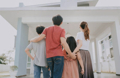 Image of a family looking at their home.