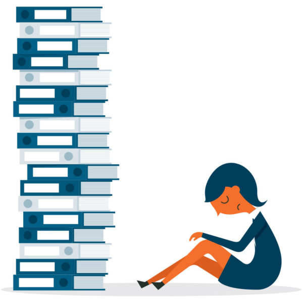 image of sad woman in front of a stack of books